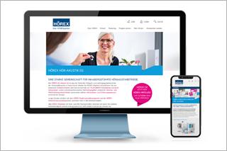 Ansicht der neuen Website auf großem Bildschirm und Smartphone